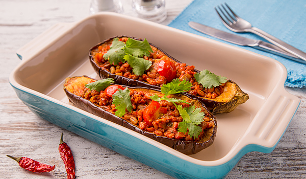 Eggplants Stuffed with Pearl Barley, Tomato and Chili