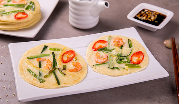 Korean pancakes with vegetables and shrimps